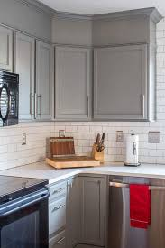 how do you fill the gap between kitchen cabinets and ceiling how to easily add height to your kitchen cabinets