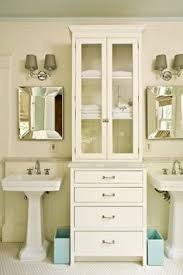 Bathroom Tall Cabinet by Double Pedestal Sinks With Tall Cabinet In Between For Storage