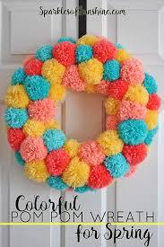 make an easy colorful pom pom wreath for spring sparkles of sunshine