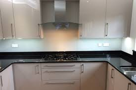 pure orange kitchen glass splashback by creoglass design london