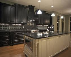 kitchen with black appliances wallpaper black and white