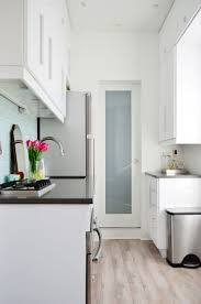 best images about fabulous studio small space apartment tiny square foot nyc studio feels much larger than modern white kitchenssmall