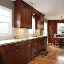 cherry cabinets with light granite countertops st cecilia light granite countertops and after new granite st new