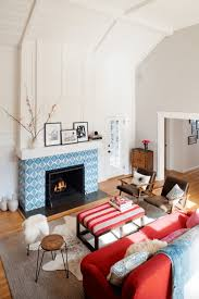 living room brown wooden floor red sofa tiled fireplace mantel