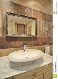 bathroom ideas wood framed large mirror above double bedroom