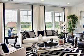 will dark carpet suit for the living room household to make a statement with black and white rugs