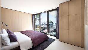 modern minimalist wooden standing bedroom cupboard in a modern minimalist bedroom