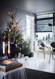 nordic living room with an asymmetric two parted christmas tree