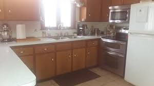 painted kitchen cabinets with stained doors 50 year wood cabinets paint or stripped and stained