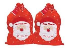 set of 2 children s personalised felt santa sacks