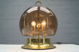 gold table lamp with mouth blown smoke globe 1960s for sale at pamono