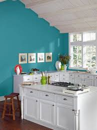 kitchen turquoise walls with white cabinets and wall pictures and