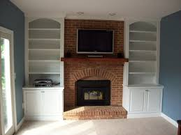 Building Wooden Bookshelves by Brown Brick Fireplace With Brown Wooden Mantel Shelf Added By