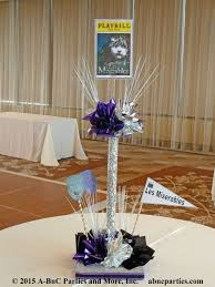 theme centerpiece favorite theater plays are themes for this bat mitzvah party