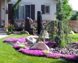 landscaping ideas on a budget yard landscaping metal chair stone