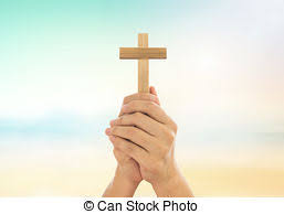 human holding christian cross with sky background picture