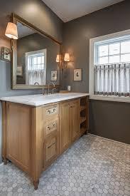 white bathroom cabinets with black countertops oak bathroom