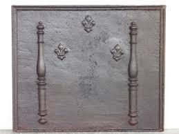 reverbere en fonte plaque cheminée ancienne contrecoeur ancien