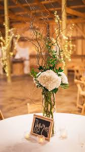 curly willow centerpieces hydrangeas and curly willow branches centerpiece barnweddings
