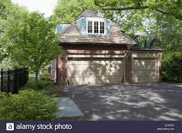 exteriors garage non attached brick three car two story garage