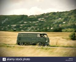 dark green volkswagen speeding dark green split screen volkswagen campervan near the