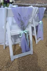 diy wedding chair covers diy folding chair covers with purple ribbons pinteres