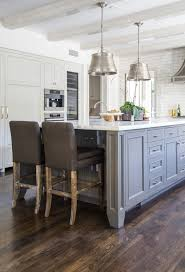 grey kitchen cabinets with brown wood floors gray center island with oak wood floors transitional