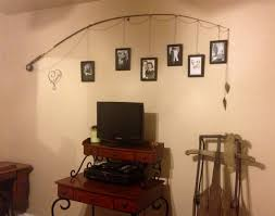 i tweaked another pinterest idea i saw for this fishing pole decor