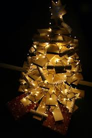 christmas branches with lights 6 ways to decorate a wooden christmas tree the hip horticulturist