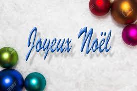 colorful balls in the snow words joyeux noel