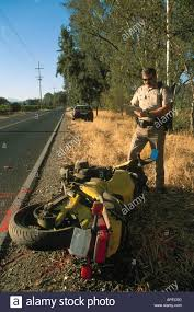 chp highway patrol police officer writing accident report after a