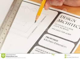 architect drawing plans for new kitchen royalty free stock