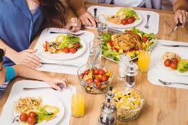 Dining Table With Food High Angle View Of Family With Food On Dining Table Stock Photo