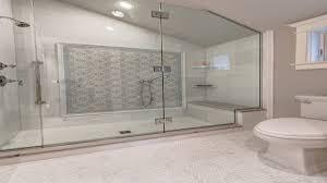 bathroom blue geometric shower accent tiles shower bench walk