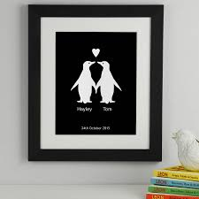 personalised penguins in love print by elephant grey artwork in midnight black with a medium black frame