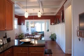 interior open floor plan kitchen dining living room pendant
