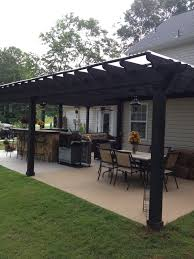 i like this open layout like the pergola over the table grill
