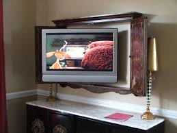 Flat Screen Tv Wall Cabinet With Doors Mount The Tv In The Great Room Inside A Cabinet Or Inside A