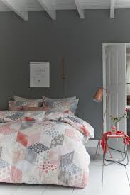 bring in some coral hues with smart fabric accents and decor blue