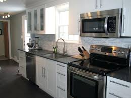 white cabinet with black countertop u2013 sequimsewingcenter com