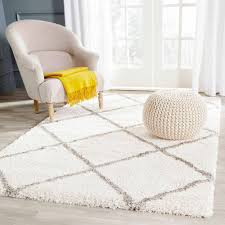 plaid area rugs rugs white plaid shaped shag area rugs with white armchair and