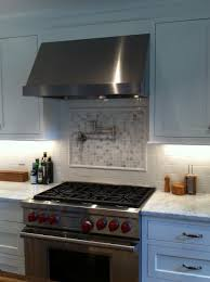 interior green and few blue penny tiles penny backsplash copper