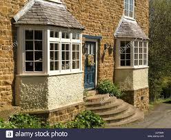 front elevation for house front elevation of attractive old stone house with bay windows and