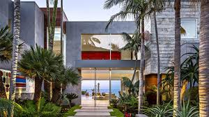 this modern home in malibu includes plenty of palm trees and