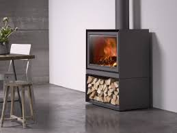 wood burning closed fireplace with panoramic glass stûv 16 cube