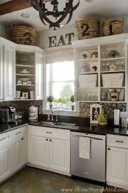 Decorations On Top Of Kitchen Cabinets Best Top Of Kitchen Cabinet Decorating Ideas Photos Liltigertoo