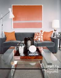 living space light gray walls dark grey couch white lamp
