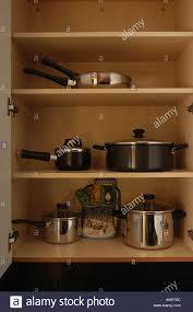 kitchen cupboard storage pans pots pans saucepans cooking shelves cupboards storage