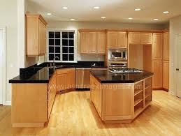 Black Counter Tops And Wood Floors With The Light Cabinets Is - Kitchen cabinet countertop