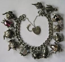 sterling silver charm bracelet charm images Vintage english 60s 70s sterling silver charm bracelet with 13 jpg